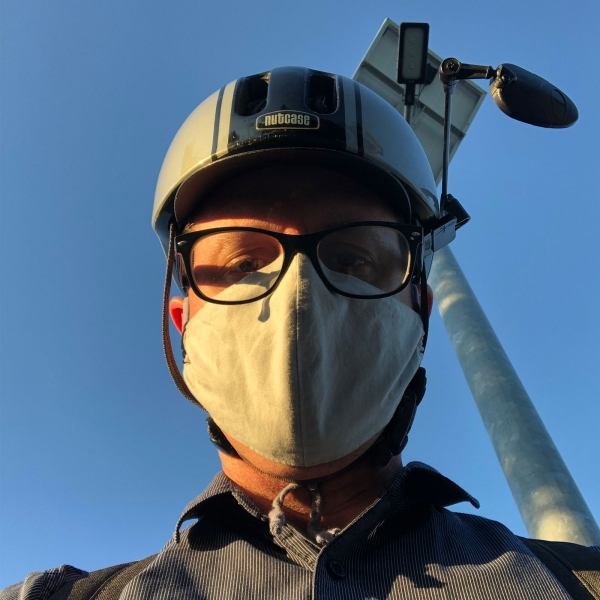 Selfie in commute mask and bike helmet