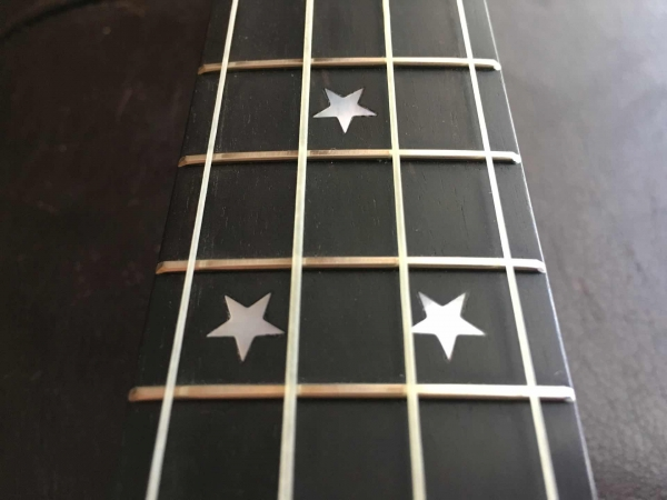 Ukulele fret board with star inlays