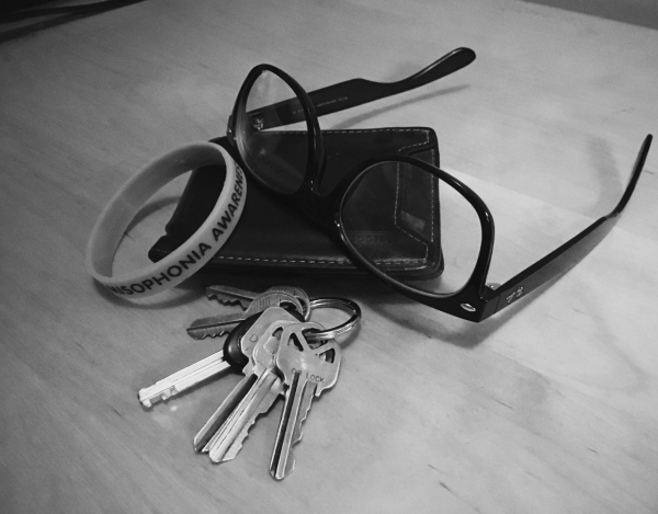 Misophonia awareness bracelet, keys, wallet and glasses