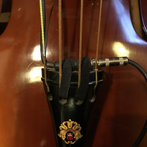 Double bass tailpiece with pickup output and cable.